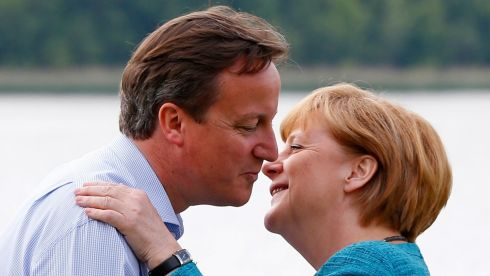 David Cameron welcomes Angela Merkel. Photograph: Yves Herman/Reuters
