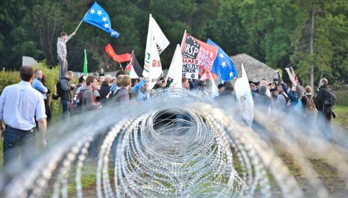 Protesters breach a razor wire fence at the outer perimeter of the security cordon at the G8 summit in Loch Erne.  Photograph: Ben Birchall/PA Wire
