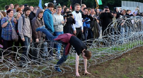Gymnastics in the razor wire. Photograph: Paul Faith/PA Wire