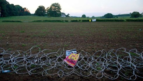 The said razor wire has taken a trampling. Photograph: Cathal McNaughton/Reuters