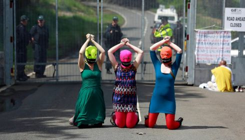 "Demonstrators with balaclavas emblazoned with ""Free Pussy Riot"" outside the G8 security fence, in reference to members of the Russian anti-Putin punk group jailed last year.  Photograph: Cathal McNaughton/Reuters"