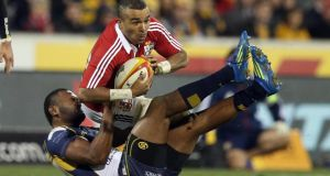 Simon Zebo is tackled by Tevita Kuridrani of Brumbies. Photograph: Dan Sheridan/Inpho