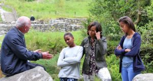 US First Lady Michelle Obama and her daughters, Malia and Sasha pictured with Tour Guide, George McClafferty during a visit to Glendalough this afternoon. Photograph: Colin Keegan/Collins.