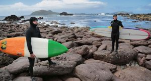 Denis DK Kane and Andrew Jacob prepare to take to the sea while filming the documentary The Crest at the Blaskets in Co Kerry. Photograph: Valerie O'Sullivan
