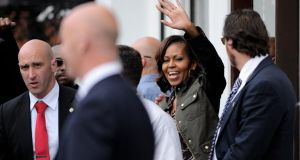 US First Lady Michelle Obama waves to the crowd as she leaves Finnegan's Pub in Dalkey where she had lunch her two daughters Sasha and Malia with Bono and his wife Ali.  Photograph: Julien Behal/PA