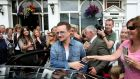 Bono leaves Finnegan's Pub in Dalkey where he had lunch with the US First Lady Michelle Obama and his wife Ali. Photograph: Julien Behal/PA Wire