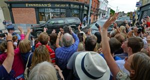 The crowd cheer as the cavalcade carrying the US First Lady Michelle Obama and her daughters, Malia and Sasha, pases through Dalkey, Co Dublin today. Photograph: Eric Luke/The Irish Times