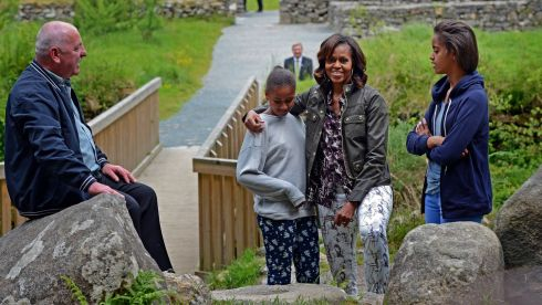 Michelle Obama and her daughters, Malia and Sasha, with tour guide George McClafferty,  at Glendalough, Co Wicklow. Photograph:  Photograph: Eric Luke/The Irish Times