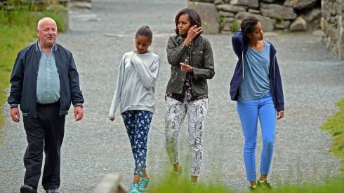 The Obamas with tour guide George McClafferty,  at Glendalough. Photograph: Eric Luke/The Irish Times