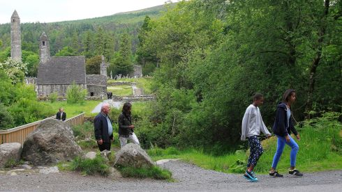 The Obamas with tour guide George McClafferty,  at Glendalough. Photograph: Julien Behal/PA Wire