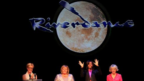 US first lady Michelle Obama acknowledges the crowd at a special Riverdance performance at the Gaiety Theated in Dublin with (left to right) Moya Dohery of Riverdance, Taoiseach's wife Fionnuala Kenny and Sabina Higgins, wife of President Michael D Higgins.  Photograph: Julien Behal/PA Wire