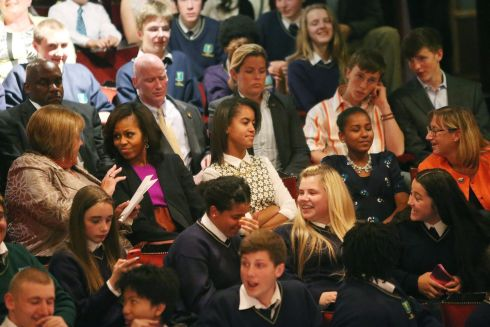 Michelle Obama chats with Fionnuala Kenny at the Gaiety, with Malia and Sasha Obama to the right. Photograph: Julien Behal/PA Wire