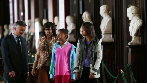 Michelle Obama with her daughters Sasha (left) and Malia Ann with Provost of Trinity College Dublin Dr Patrick Prendergast during their visit to the Long Room Library in Trinity, where they viewed the Book of Kells. Photograph: Julien Behal/PA Wire