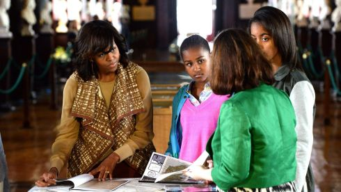 Michelle Obama with her daughters viewing the Obama Family Collection, with Fiona Fitzsimons (right), director of genealogy research service Eneclann, during their visit to the Long Room Library at Trinity College Dublin. Photograph: Cyril Byrne/The Irish Times
