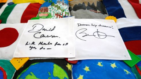 The signatures of British Prime Minister David Cameron and US President Barack Obama on a patchwork quilt made by students working on a school project about the G8 summit. Photograph: Matt Dunham/PA Wire