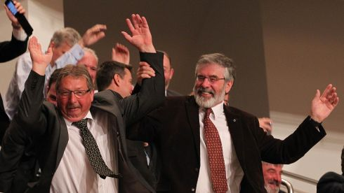 Northern Ireland Minister for Finance Sammy Wilson participates in an audience wave with Sinn Féin leader and TD Gerry Adams this morning while waiting for US President Barack Obama to make his keynote address during his visit to the Waterfront Hall, Belfast ahead of the G8 Summit. Photograph: Brian Little/Presseye/PA Wire