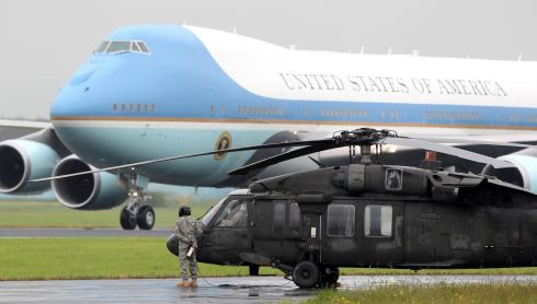 Air Force One arrives at Belfast International Airport with the US president on board, with a US blackhawk military helicopter in the foreground. Photograph: Peter Muhly/WPA Pool/Getty Images