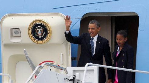 US President Barack Obama waves as he exits Air Force One at Belfast International Airport with his daughter Sasha. Photograph: Ben Birchall/PA Wire