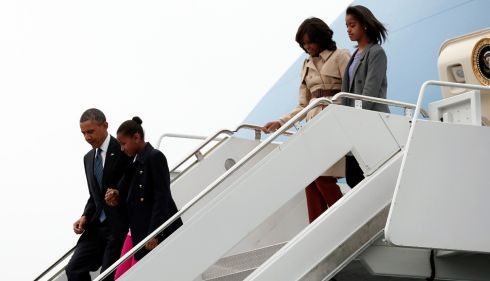 President Obama with daughter Sasha and first lady Michelle Obama with daughter Malia disembark from Air Force One. Photograph: Kevin Lamarque/Reuters