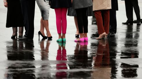 A very Irish welcome: US President Barack Obama and his family stand on the Belfast tarmac with officials amid light rain. Photograph: Kevin Lamarque/Reuters