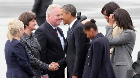 The Obamas greet Northern Ireland's Minister for Enterprise, Trade and Investment Arlene Foster (centre), Minister for Agriculture and Rural Development Michelle O'Neill and Minister of State for Northern Ireland Mike Penning at the airport. Photograph: Darren Kidd/Presseye.com/PA Wire