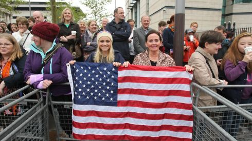 Crowd members wave the Stars and Stripes  as Barack Obama arrives at Belfast Waterfront Hall Photograph: Niall Carson/PA Wire