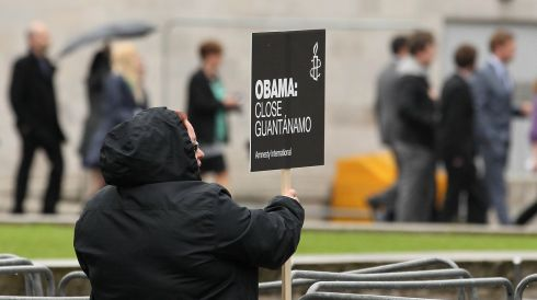 An Amnesty International supporter at a picket outside the Belfast Waterfront Hall as US President Barak Obama delivers his keynote address. Photograph: Niall Carson/PA Wire