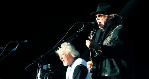 Neil Young and Crazy Horse pictured performing in The RDS, Dublin on Saturday night. Photograph: Aidan Crawley