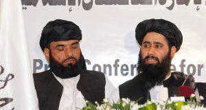 Muhammad Naeem (right), a spokesman for the office of the Taliban of Afghanistan speaks during the opening of the Taliban Afghanistan political office in Doha. Photograph: Mohammed Dabbous/Reuters