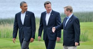 """For the Taoiseach it was an image to die for. There's nothing a leader likes more than proximity to more powerful leaders."" US president Barack Obama, British prime minister David Cameron and Taoiseach Enda Kenny take a walk at the G8 summit at Lough Erne in Fermanagh. Photograph: Laura Hutton/Photocall Ireland"