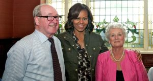 Michelle Obama with Dan Finnegan  and Colleen Finnegan at Finnegan's pub in Dalkey. Photograph: Barry Moore/Photogenic