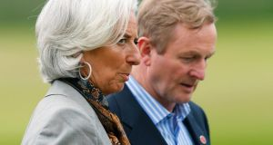 Taoiseach  Enda Kenny  and International Monetary Fund managing director Christine Lagarde after a G8 summit group photograph at Lough Erne, Enniskillen, yesterday. Photograph: Reuters/Andrew Winning