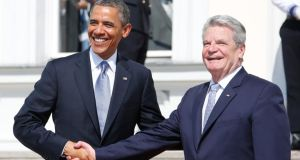 US president Barack Obama shakes hands with German president Joachim Gauck  during a welcoming ceremony at Bellevue Palace in Berlin today. Photograph: Reuters