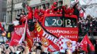 Manchester United players standing in an open-topped bus cheer during the team's victory parade to celebrate winning the Premier League for the 13th time.  Photograph:  Lindsey Parnaby/Getty Images
