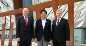Japanese prime minister Shinzo Abe  visits Titanic Belfast with First Minister Peter Robinson and deputy First Minister Martin McGuinness yesterday. Photograph:  Kelvin Boyes/Press Eye/PA Wire