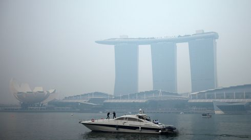 A yacht sails past the hazy skyline of Marina Bay Sands casino and resort in Singapore amid a smoky backdrop being blamed on Indonesian fires. Singapore's worst air pollution in 16 years has sparked diplomatic tension, as the city-state urged Indonesia to provide data on company names and concession maps to enable it to act against plantation firms that allow slash-and-burn farming. Photograph: Edgar Su/Reuters