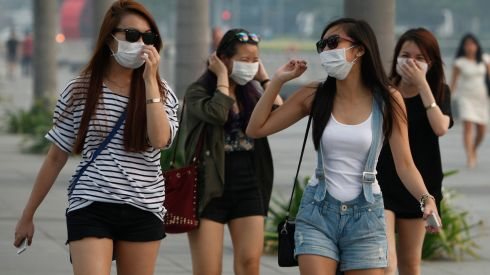 Mask-wearing women walk to The Shoppes at Marina Bay Sands in Singapore. Photograph: Edgar Su/Reuters