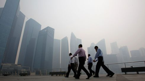 Singapore's tall buildings scrape through the smog. Photograph: Edgar Su/Reuters