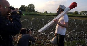 A protester dressed as Osama Bin Laden at the security fencing outside the G8 summit in Lough Erne, Co Fermanagh. Photograh: Paul Faith/PA Wire