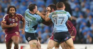 Paul Gallen of the New South Wales Blues and Nate Myles of the Queensland Maroons during a controversial incident in game one of the popular ARL State of Origin series at ANZ Stadium in Sydney, Australia. Phtograph: Mark Metcalfe/Getty Images