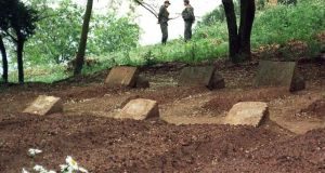 Soldiers guarding the graves of seven French Trappist monks, at their monastery in Tibhirine in May 1996. Photograph: STR/AFP/Getty Images