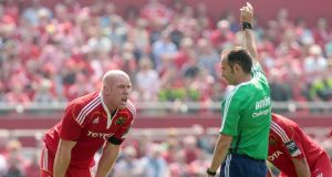Munster's Paul O'Connell at odds with referee Romain Poite in an Amlin Cup tie.