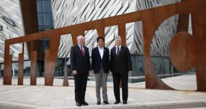 Japan's prime minister Shinzo Abe joins First Minister Peter Robinson and Deputy First Minister Martin McGuinness during a visit to the Titanic visitor centre in Belfast yesterday. Photograph: Peter Morrison/AP Photo