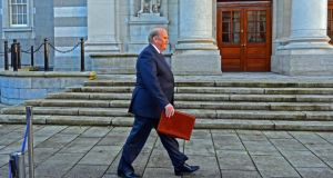 Minister for Finance Michael Noonan at Government Buildings on his way to present his budget to the Dáil last year. Photograph: Eric Luke