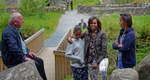 US First Lady Michelle Obama and her daughters, Malia and Sasha, with tour guide George McClafferty, at Glendalough on Tuesday. Security surrounding their visit cost millions of euro. Photograph: Eric Luke/The Irish Times