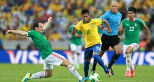 Gerardo Torrado of Mexico challenges Neymar of Brazil during the FIFA Confederations Cup Brazil 2013 Group A match  in Fortaleza, Brazil. Photograph:  Scott Heavey/Getty Images