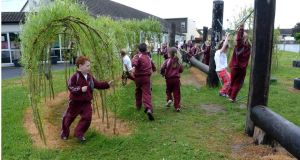 Darragh Crowley runs through the willow tunnel made by the children during the school's active schools programme. Photograph: Brenda Fitzsimons
