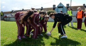 Maire Louise Reilly of the Irish Womens Team plays ball with the school's pupils. Photograph: Brenda Fitzsimons