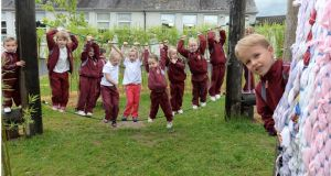Olaf Liukowska with fellow pupils playing outdoors. Photograph: Brenda Fitzsimons