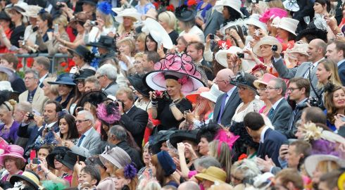 Racegoers watch the arrival Queen Elizabeth II for day three of the Royal Ascot meeting at Ascot Racecourse, Berkshire. Photograph: Tim Ireland/PA Wire